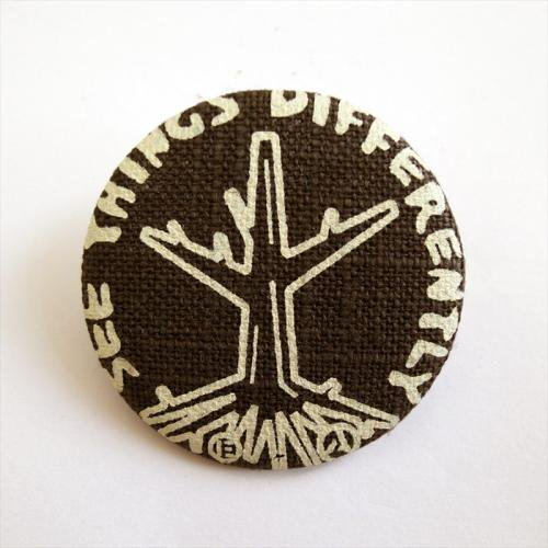 ACT / ROOTS BADGE - KHAKI