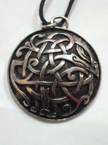 Celtic pendants / Book of kells Serpent and Beast