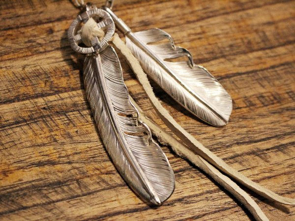 FEATHER (L) with MEDICINE WHEEL / SUNSHINE STUDIO