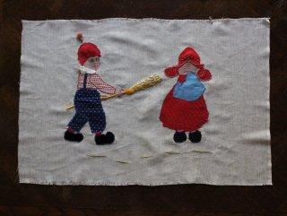 「いたずらっ子」の縫い取り作品